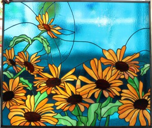 Black eyed Susan's on blue