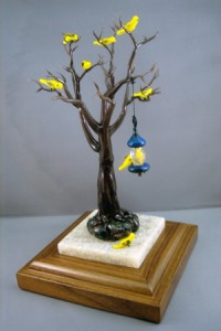 Blown glass tree full of birds